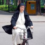 Nun on a bike